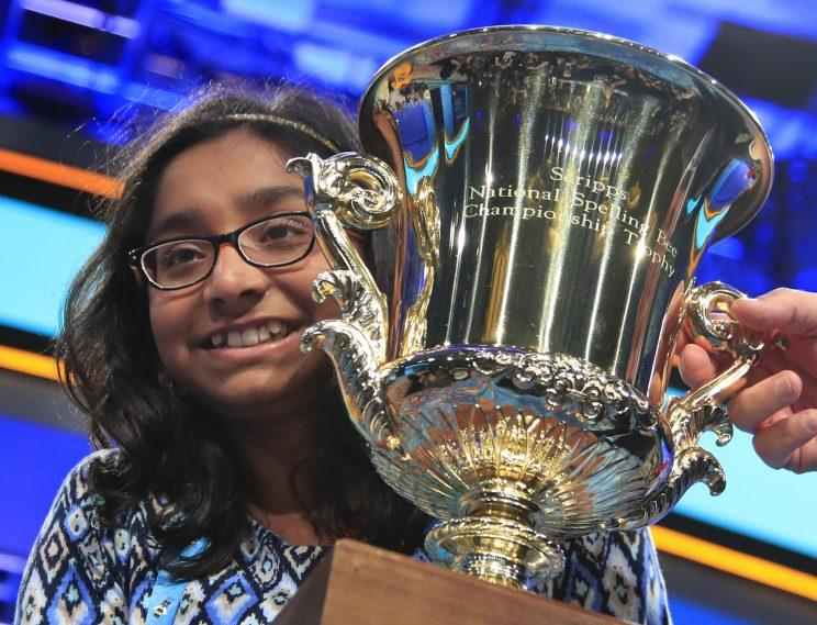 Ananya Vinay holds her trophy after being declared the winner of the 90th Scripps National Spelling Bee