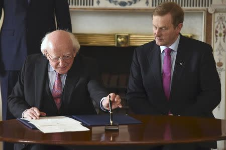 President Michael D. Higgins prepares to sign Prime Minister Enda Kenny's (R) Seal of Government to office of Taoiseach in Dublin, Ireland May 6, 2016. REUTERS/Clodagh Kilcoyne