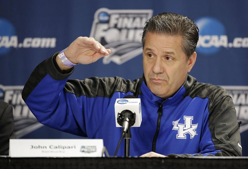 Kentucky head coach John Calipari answers a question during a news conference for the NCAA Final Four tournament college basketball championship game Sunday, April 6, 2014, in Arlington, Texas. Kentucky plays Connecticut in the championship game on Monday, April 7. 2014