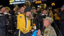 Woman in marching band gets surprise proposal from Army boyfriend