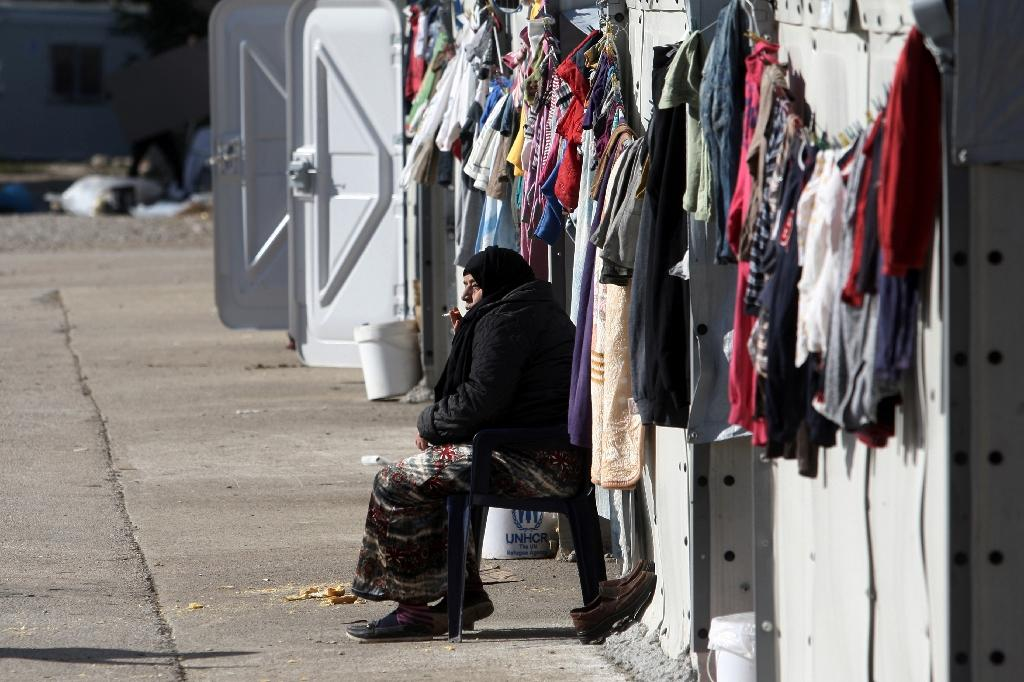EU threatens fines for failing to take in refugees