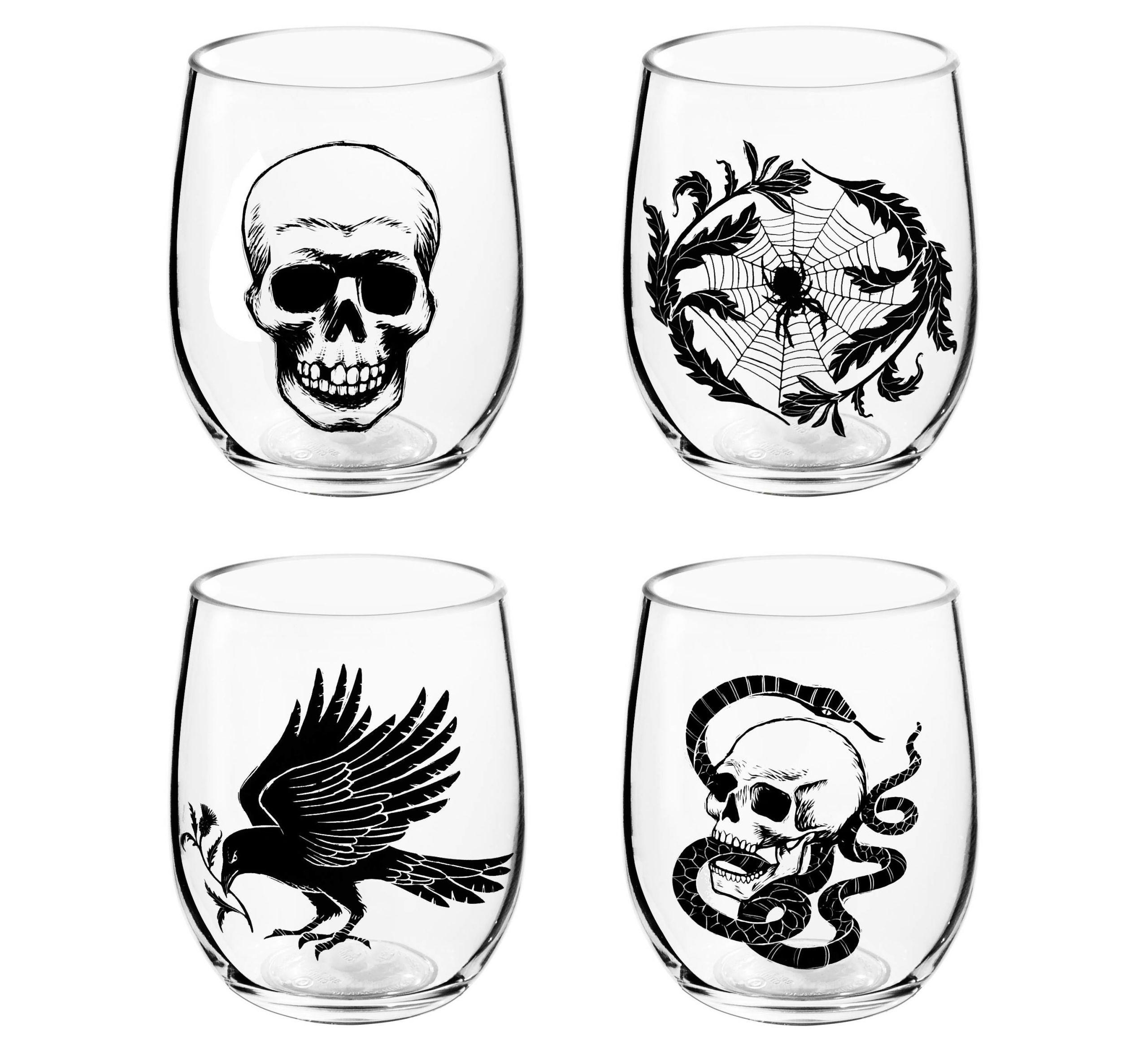 """<p><span>These spooky glasses feature a skull, raven, skull and snake, and a spider web. Order a few and serve your Hallow's Eve <a href=""""http://www.delish.com/holiday-recipes/halloween/g3044/halloween-punch/"""" rel=""""nofollow noopener"""" target=""""_blank"""" data-ylk=""""slk:punch"""" class=""""link rapid-noclick-resp"""">punch</a> in 'em.</span></p><p><strong>Price</strong><span>: $8</span></p><p><a href=""""https://www.target.com/p/4ct-halloween-nocturne-stemless-wine-glass-set-skull-spider-snake-raven-hyde-and-eek-boutique-153/-/A-52291146#lnk=newtab"""" rel=""""nofollow noopener"""" target=""""_blank"""" data-ylk=""""slk:Get them here."""" class=""""link rapid-noclick-resp"""">Get them here.</a></p>"""