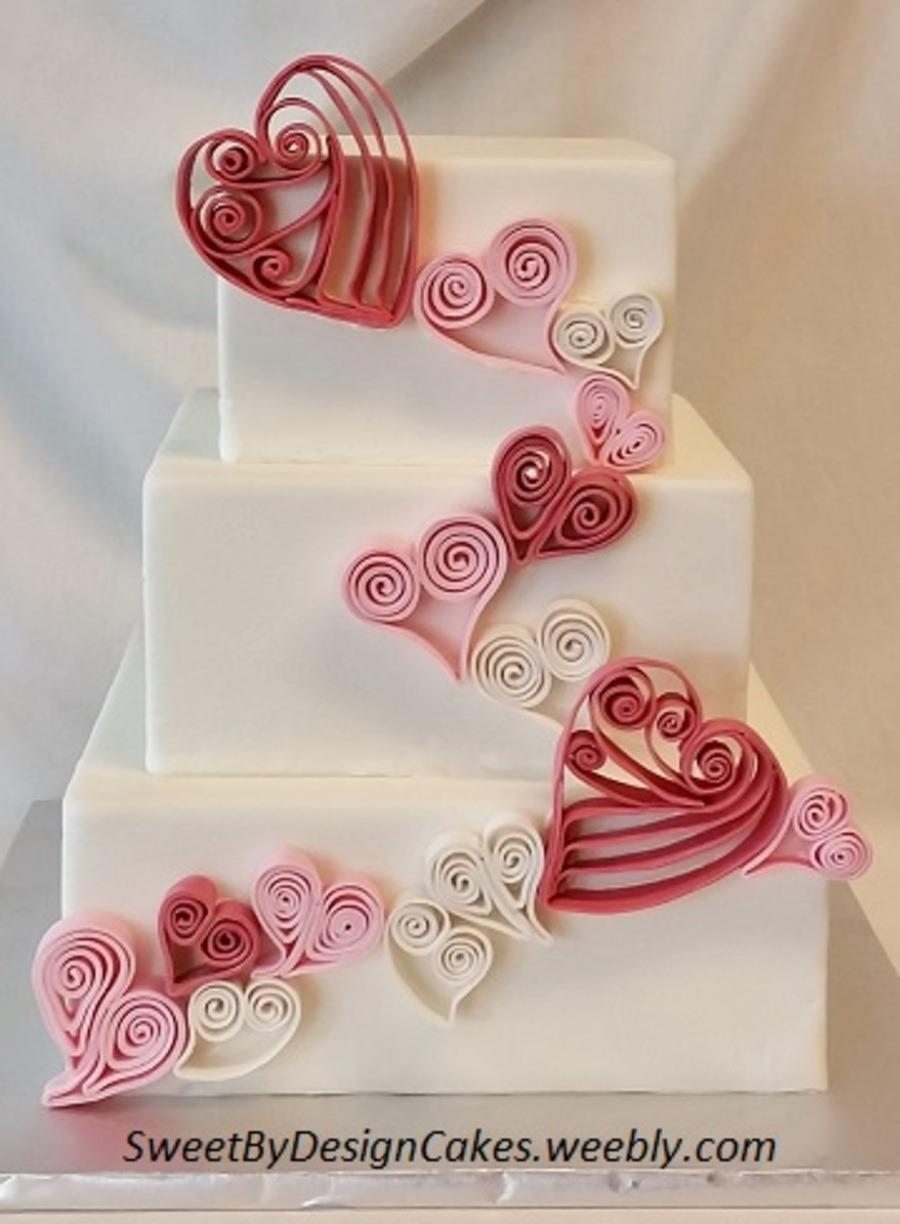 """<p>Probably a little too ambitious for most of us to replicate. <i>[Photo: <a href=""""http://www.cakecentral.com/gallery/i/3329305/quilled-hearts"""" rel=""""nofollow noopener"""" target=""""_blank"""" data-ylk=""""slk:Sweet By Design Cakes"""" class=""""link rapid-noclick-resp"""">Sweet By Design Cakes</a>]</i></p>"""