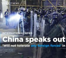 China says it won't 'tolerate any foreign forces' in Hong Kong
