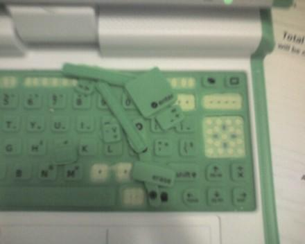 OLPC keyboards literally being ripped apart