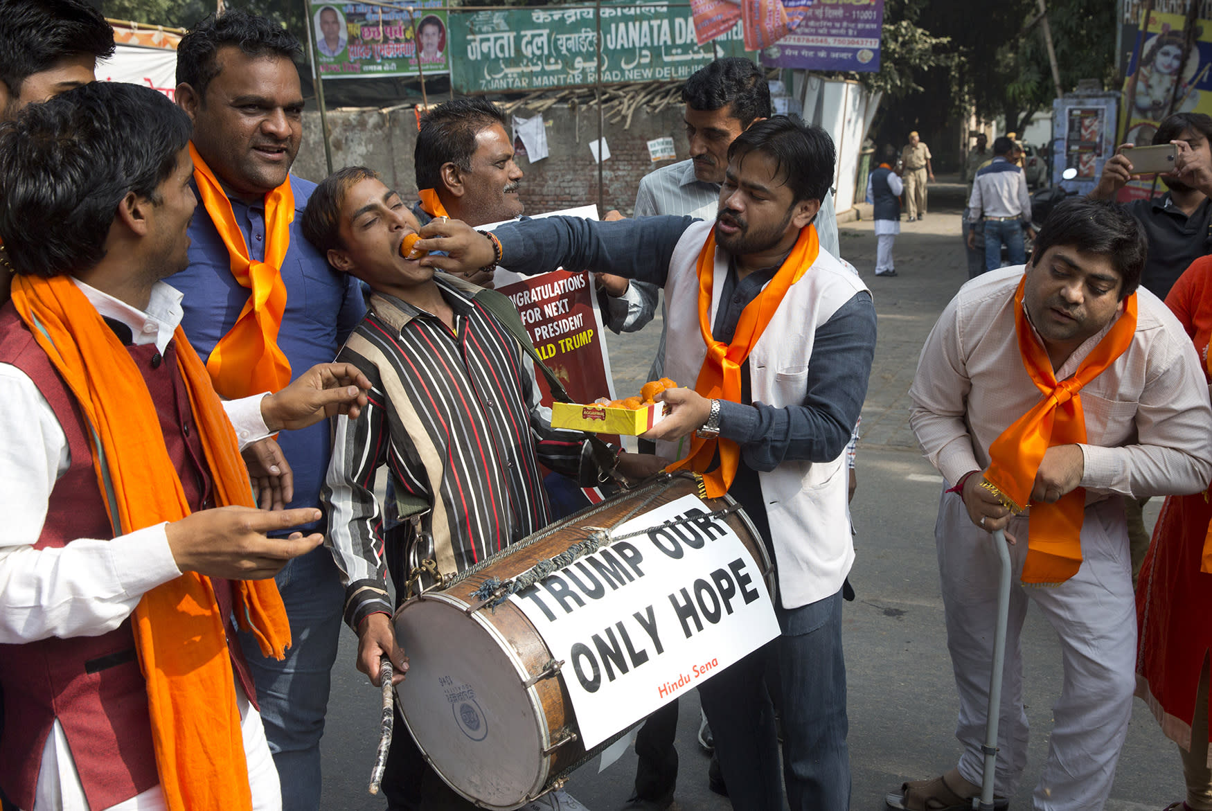 <p>Activists of the Hindu Sena, or Hindu Army, a local organization offer sweets to each other in anticipation of the wining of U.S. presidential candidate Donald Trump in New Delhi, India, Wednesday, Nov. 9, 2016. (AP Photo/Manish Swarup) </p>