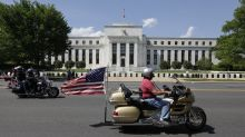 Stocks end choppy session slightly lower after Fed minutes