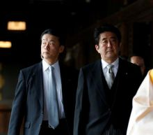 Yasukuni Shrine: Japan's ex-PM Abe visits controversial memorial
