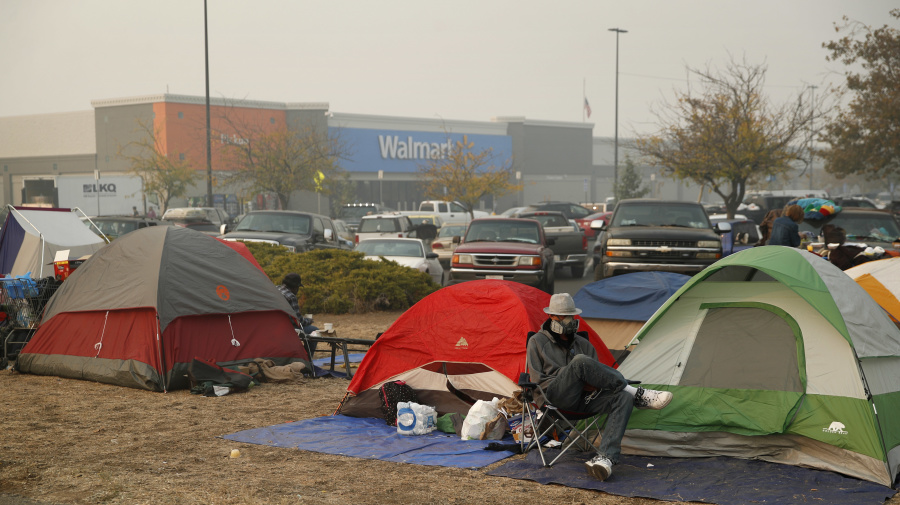 Weather may bring more misery to wildfire evacuees