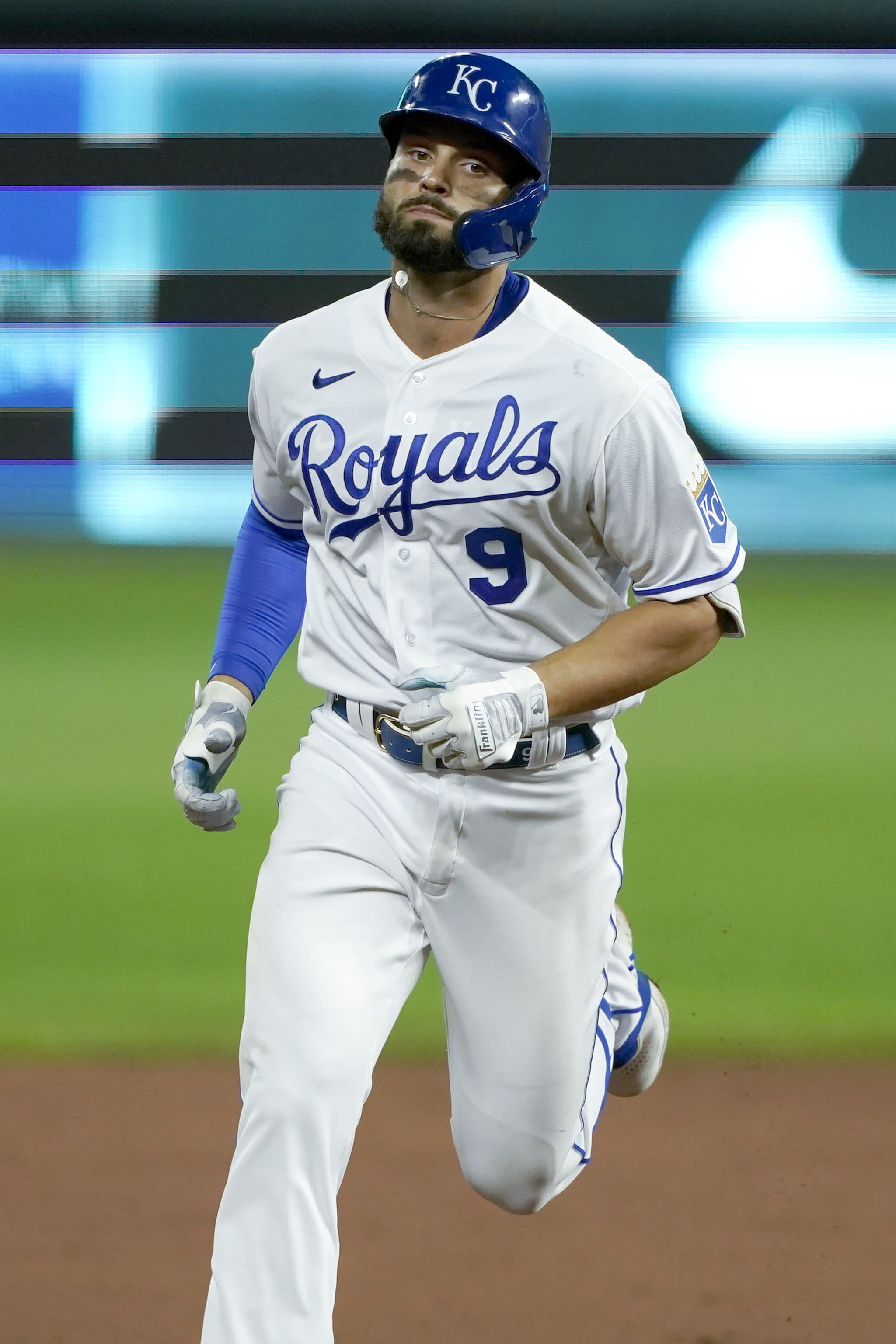 Kansas City Royals' Ryan McBroom rounds the bases after hitting a solo home run during the sixth inning of a baseball game against the Chicago White Sox Friday, July 31, 2020, in Kansas City, Mo. (AP Photo/Charlie Riedel)