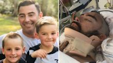 Hero dad fights for life after plunging from balcony to save his son