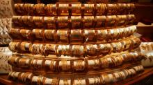Gold hits three-week high as global growth fears lift safe-haven appeal