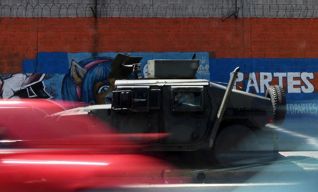 A military vehicle patrols in El Salvador to fight violence blamed on street gangs