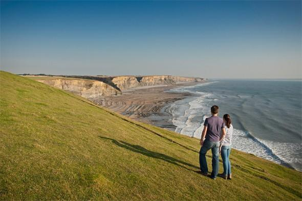 "<p>This fabulous walk combines two uniquely beautiful county areas: the <a href=""http://www.glamorganheritagecoast.com/"" target=""_blank"">Vale of Glamorgan and Bridgend</a>. The 28 miles of coastal scenery (dramatic cliffs, golden sandy beaches, seaside towns and ancient castles) stretches from Porthcawl to Penarth - essentially Swansea to Cardiff. The best sandy spots along the route are Barry Island and Porthcawl, which happens to be home to some of the UK's top surfing. Don't miss one of the most fascinating landscapes in the UK, the Merthyr Mawr sand dunes. You can enjoy the sun by lounging on a dune or take a sledge to the Big Dipper, the biggest sand dune in Europe! <strong>Best for: Adventurers.</strong></p>"