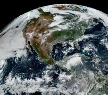 Watch the moon's shadow slide across the U.S. from space