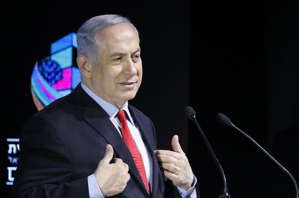 """Israeli Prime Minister Benjamin Netanyahu says his government remains """"stable"""", on February 14, 2018. a day after police recommended his indictment for corruption, prompting calls for him to resign (AFP Photo/Jack GUEZ)"""
