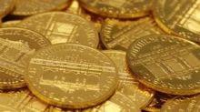 Oro recupera terreno ante estabilidad del dólar y baja de acciones