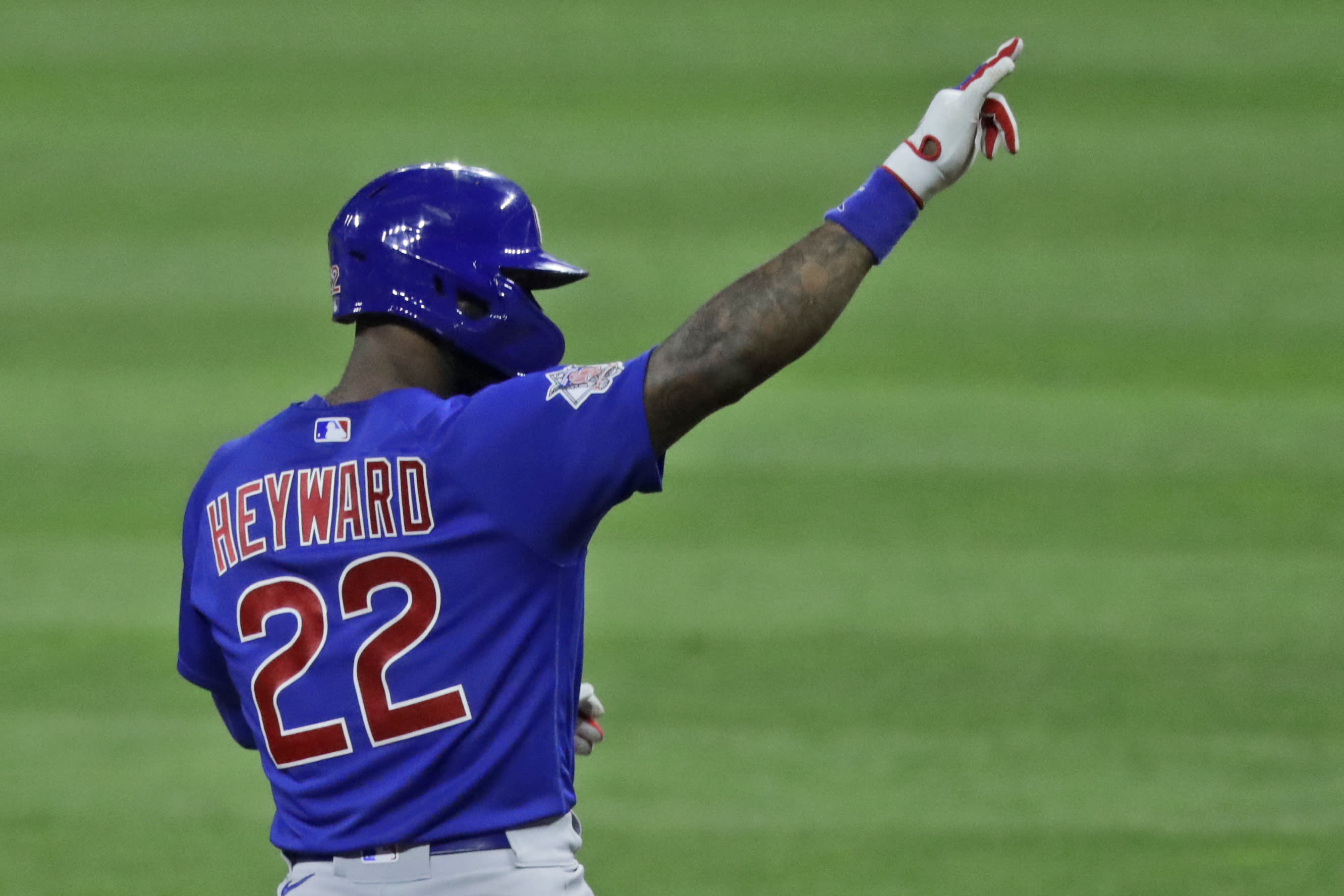 Chicago Cubs' Jason Heyward points toward the dugout after hitting a one-run double in the ninth inning in a baseball game against the Cleveland Indians, Wednesday, Aug. 12, 2020, in Cleveland. (AP Photo/Tony Dejak)