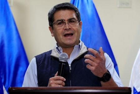 FILE PHOTO: Honduras President and National Party candidate Juan Orlando Hernandez gestures as he addresses the media at the Presidential House in Tegucigalpa, Honduras on December 5, 2017. REUTERS/Jorge Cabrera/File Photo