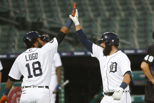 Detroit Tigers' Austin Romine, right, celebrates his two-run home run with Dawel Lugo (18) against the Chicago White Sox in the fifth inning of a baseball game in Detroit, Tuesday, Aug. 11, 2020. (AP Photo/Paul Sancya)