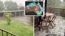 Melbourne lashed by hail as huge downpour complicates Victorian fire fighting effort