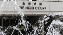 Man walks free from Hong Kong court after daughter admits making up rape allegations against him