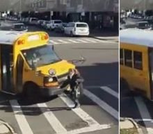 Horrifying Video Shows Woman in Crosswalk Being Run Over and Dragged by School Bus