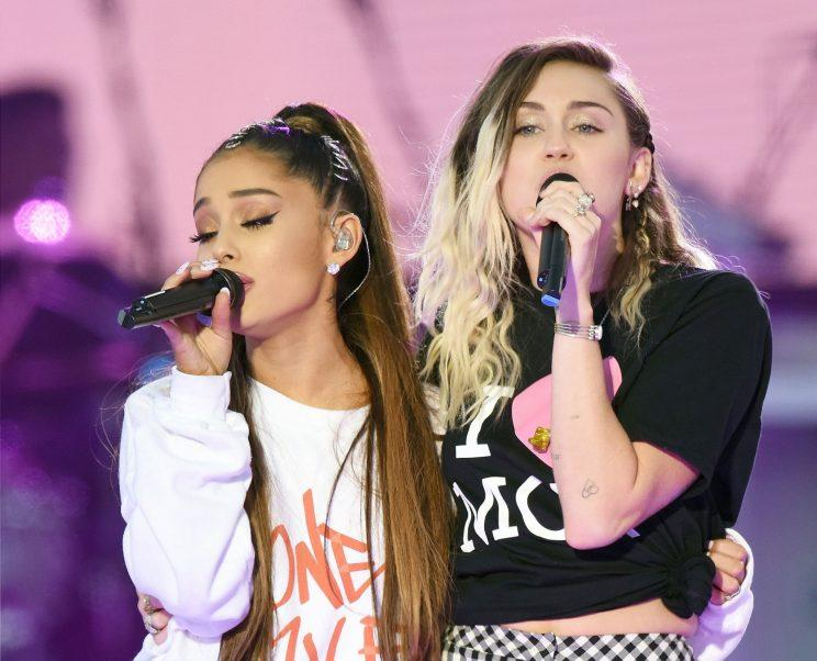 Ariana Grande, left, and Miley Cyrus perform at the One Love Manchester tribute concert in Manchester. Photo: (Dave Hogan via AP)