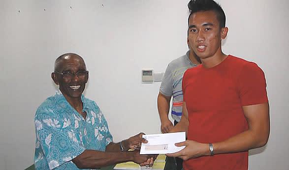 National Hurdler Zaki Sapari (right), Seen Here With National Track Legend  C Kunalan