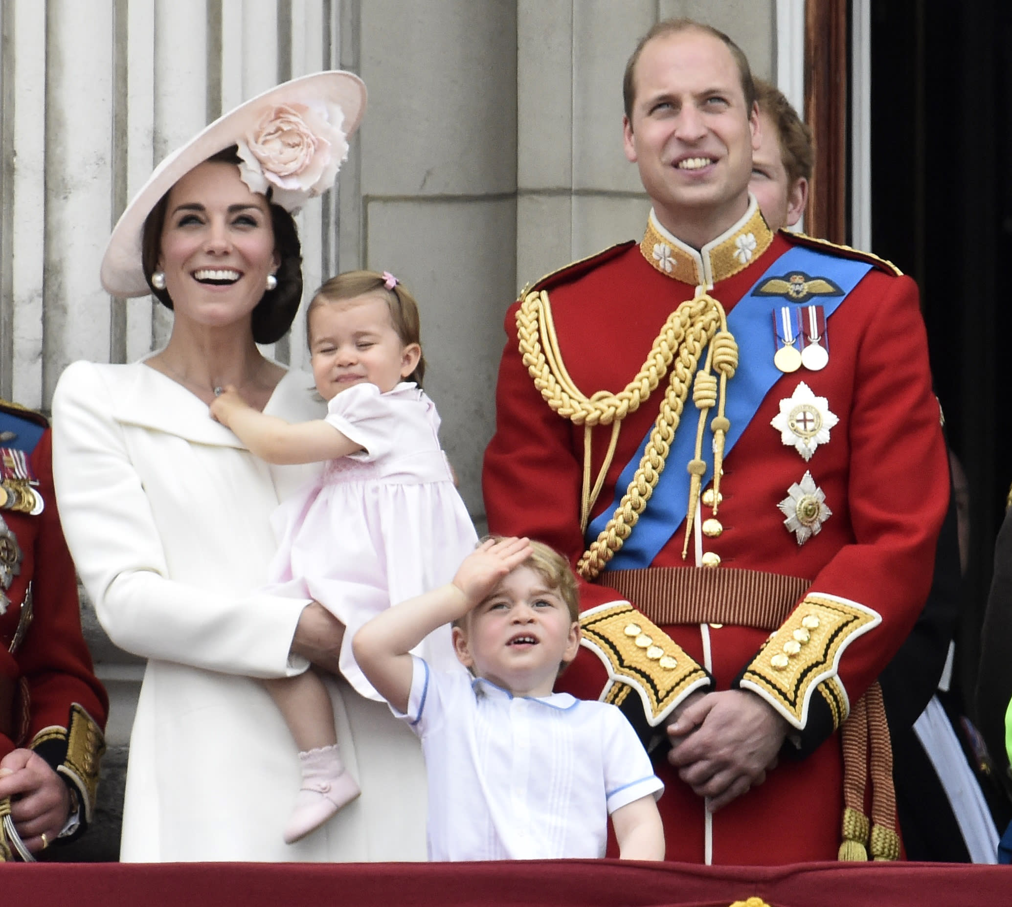 Catherine, Duchess of Cambridge holding Princess Charlotte, Prince George and Prince William, watch a flypast as they stand on the balcony of Buckingham Palace after the annual Trooping the Colour ceremony on Horseguards Parade in central London, Britain June 11, 2016. Trooping the Colour is a ceremony to honour Queen Elizabeth's official birthday. The Queen celebrates her 90th birthday this year.   REUTERS/Toby Melville