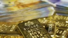 Gold falls on strong dollar, higher U.S. yields