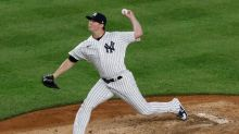 Yanks exercise Britton option, decline Gardner and Happ