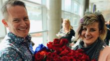 Husband surprises wife with reenactment of airport proposal 25 years later