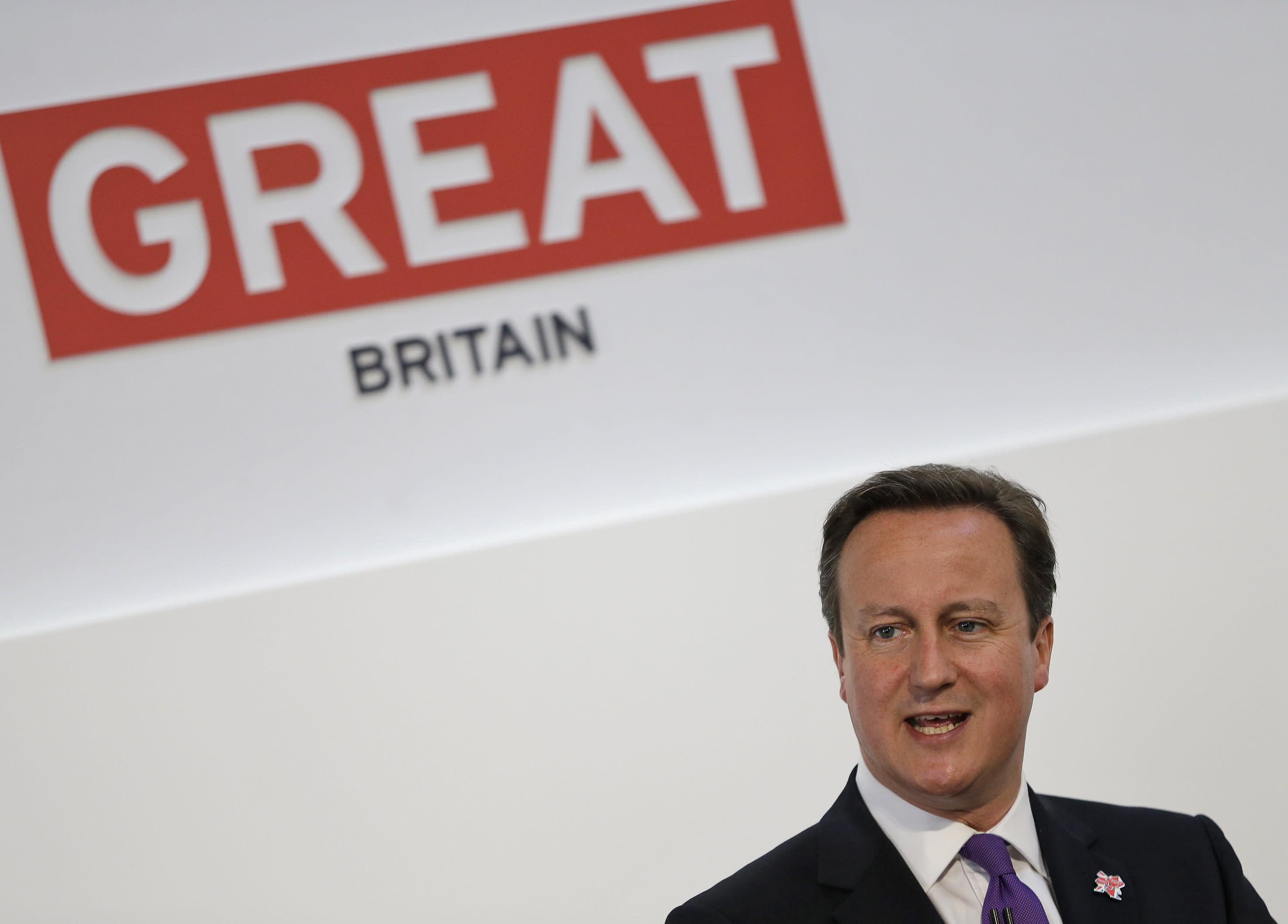 Britain's Prime Minister David Cameron speaks at the British Business Embassy conference in London, Thursday, July 26, 2012. The British government is trying to drum up business, a day after figures showed the country's economy is in a deeper recession than previously thought. On the eve of the start of the Olympic Games, the government has gathered around 4,000 business leaders and international policymakers in London as it attempts to clinch over 1 billion pounds worth of deals and projects this summer. (AP Photo/Alastair Grant, Pool)