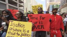 Family and friends of George Floyd march through Houston