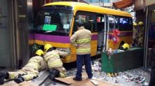 Two dead and 12 injured after runaway school bus hits pedestrians in Hong Kong
