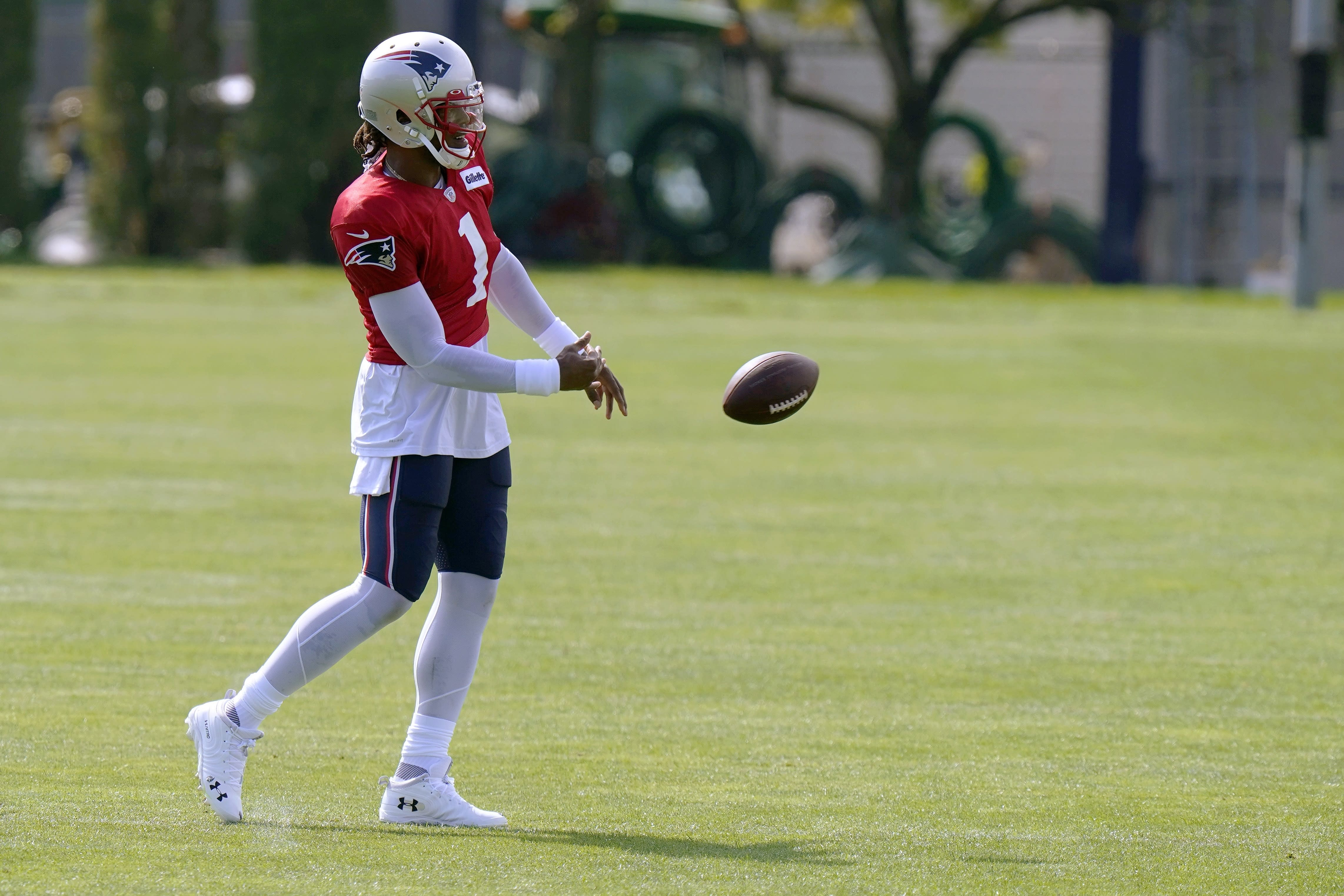 New England Patriots quarterback Cam Newton tosses the football during an NFL football training camp practice, Monday, Aug. 24, 2020, in Foxborough, Mass. (AP Photo/Steven Senne, Pool)