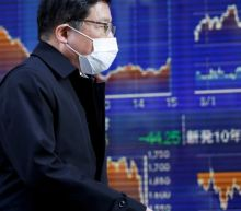 Asian shares grind lower amid vaccine doubts, economic concern