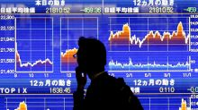 Global stocks rise, dollar slips as traders price in accommodative Fed stance