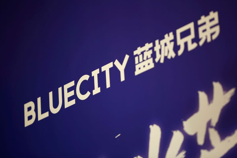 Sign of BlueCity Holdings Ltd, the owner of China's biggest dating app for gay men, is seen ahead of the company's debut on Nasdaq, in Beijing