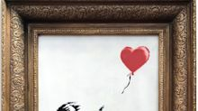 'You've been Banksy'ed': Painting suddenly shreds itself after selling for £1 million