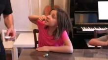 Dad uses vacuum cleaner to pull daughter's loose tooth