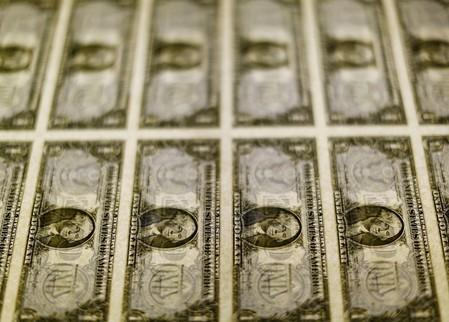 Dollar holds steady on reduced bets on steep U.S. rate cut