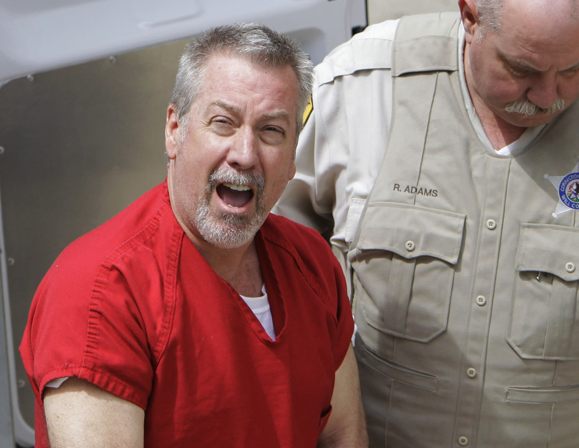 FILE - In this May 8, 2009 file photo, former Bolingbrook, Ill., police sergeant Drew Peterson arrives at the Will County Courthouse in Joliet, Ill., for his arraignment on charges of first-degree murder in the 2004 death of his third wife Kathleen Savio. On Thursday, Feb. 21, 2013, Will County Judge Edward Burmila sentenced Peterson to 38 years in prison for Savio's murder. (AP Photo/M. Spencer Green, File)