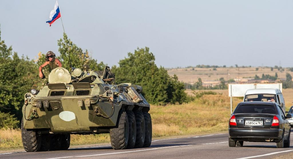 An armoured personnel carrier drives on a road near the town of Kamensk-Shakhtinsky in the Rostov region, some 30 km from the Russian-Ukrainian border, on August 15, 2014 (AFP Photo/Dmitry Serebryakov)