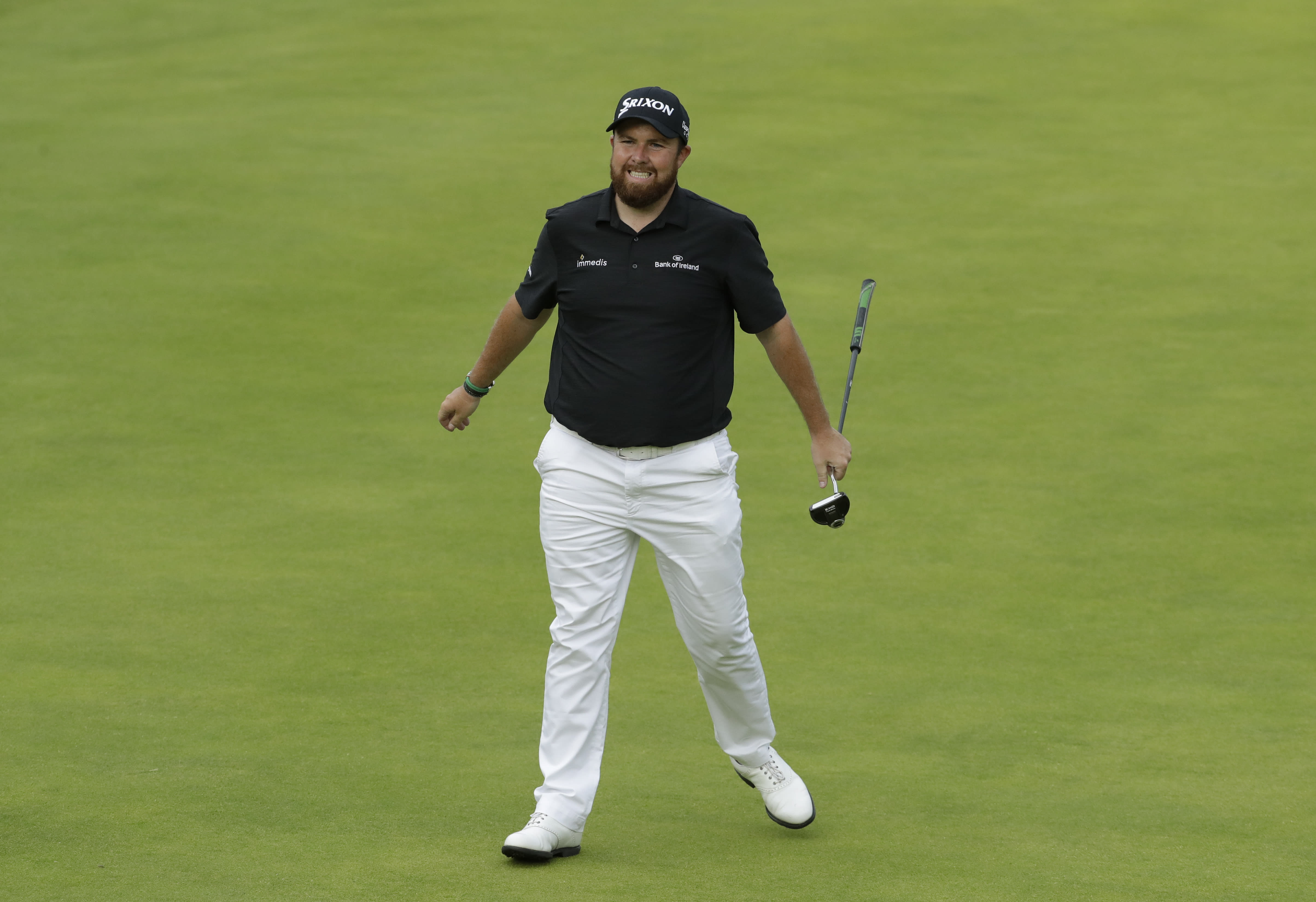 Ireland's Shane Lowry reacts after putting on the 18th green during the third round of the British Open Golf Championships at Royal Portrush in Northern Ireland, Saturday, July 20, 2019.(AP Photo/Matt Dunham)