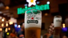 Heineken says first-half revenue falls due to COVID-19, shares slide