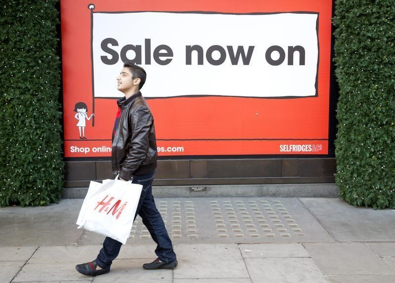 a7fcb2e4d7b A shopper walks past a sale sign on Oxford Street in central London