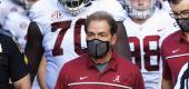 Alabama coach Nick Saban leads his team to the field. (AP)