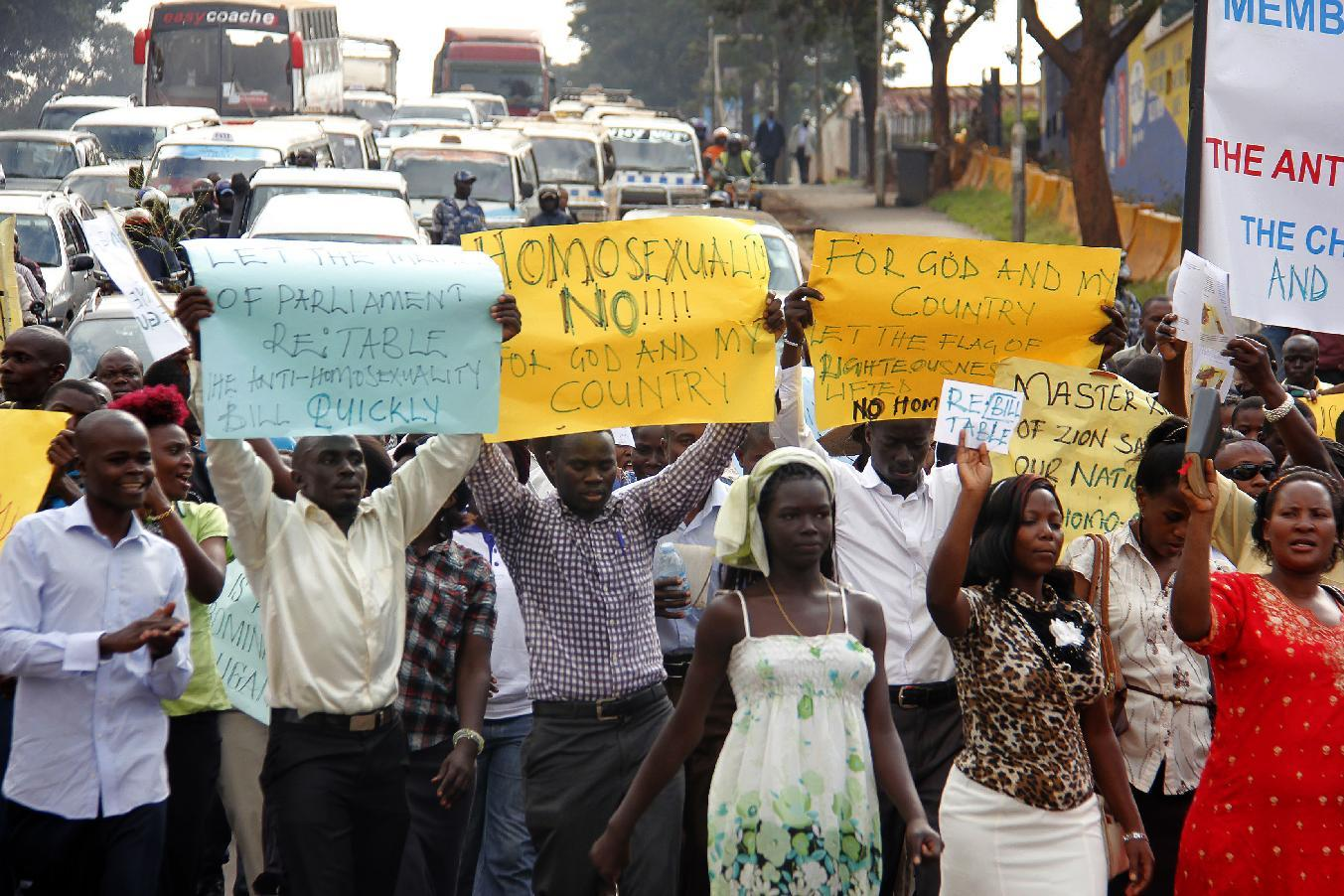 Anti-gay activists march on the streets of Kampala on August 11, 2014 after the new laws were annulled (AFP Photo/Isaac Kasamani)